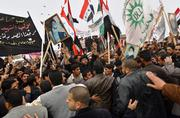 Iraqis rally in protest of British military presence in Basra, Iraq's second-largest city. Authorities in the southern Iraqi province severed all ties with Britain on Tuesday amid the furor of the alleged British military abuse of several Iraqi males two years ago in Amarah.