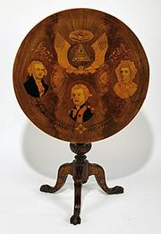 President George Washington, his wife and Baron Von Steuben, a Prussian officer who served at Valley Forge, are pictured on this table made in the late 19th century. MastroNet online auction sold the table for $12,900.