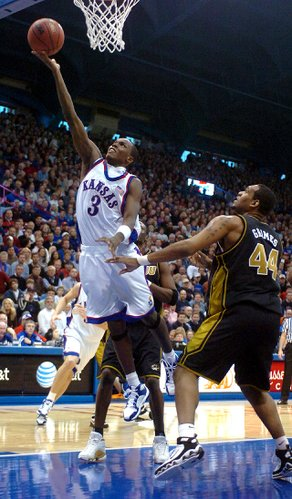 Kansas guard Russell Robinson drives in to the bucket against Missouri defender Kalen Grimes in the second half.