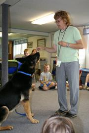 Toby Young works with a dog as part of the Safe Harbor Prison Dog program
