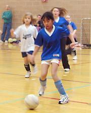Cub Kayla Duncan kicks the ball toward the goal Saturday at the East Lawrence Center.