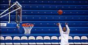 Kansas forward Darnell Jackson shoots around Tuesday evening prior to the start of the Jayhawks' game against Baylor at Allen Fieldhouse.