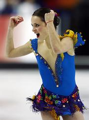 Sasha Cohen competes in the short program. Cohen led the women's figure skating Tuesday in Turin, Italy.