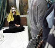 An injured Iraqi girl sits on a bed in Yarmouk hospital in Baghdad following an explosion at an outdoor market in a Shiite area of southwestern Baghdad, killing 22 people and injuring 28, police said. Tuesday's attack appeared to be the deadliest car bombing against civilians in the capital in weeks.