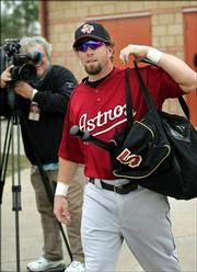 Houston Astros' infielder Jeff Bagwell arrives suited up for the first time this season at spring training in Kissimmee, Fla., Friday, Feb. 24, 2006.