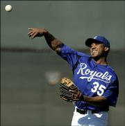 Kansas City Royals outfielder Emil Brown throws the ball during spring training baseball Friday, Feb. 24, 2006 in Surprise, Ariz.
