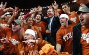 ESPN basketball guru Dick Vitale hams it up for the cameras with the Longhorn student section prior to the start of Saturday night's game against Kansas at the Frank Erwin Center in Austin. ESPN College Gameday is being broadcast from UT.