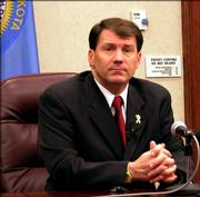 Gov. Mike Rounds answers questions about a bill that would ban abortions in the South Dakota Friday, Feb. 24, 2006, in Pierre, S.D. Rounds says he will have to see the bill before he decides what action he will take on it.
