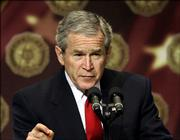 "President Bush pauses during a lengthy address on the global war on terrorism at a gathering of the American Legion in Washington, Friday, Feb. 24, 2006. Bush says the situation in Iraq remains ""serious."" But the president also says he&squot;s ""optimistic"" Iraqis will turn away from civil warfare in what he calls their ""moment of choosing"" after scores of people have died since the bombing of a landmark Shiite mosque."