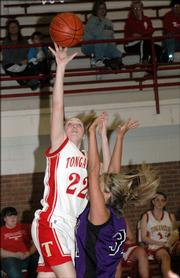 Tonganoxie sophomore Shannon Carlin (22) puts up a shot against Kansas City Piper. The Chieftains hammered the Pirates, 72-32, Monday in Tonganoxie.