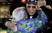 Buck O'Neil receives a hug from Albertine Morgan of Kansas City after a press conference for the former Kansas City Monarch at the Negro Leagues Baseball Museum in Kansas City Monday, Feb. 27, 2006. O'Neil was not included in a group of 17 former players and executives with the Negro Leagues inducted into the National Baseball Hall of Fame in Cooperstown, N.Y.