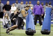 Charlton Keith of Kansas participates in drills during the NFL scouting combine in Indianapolis, Monday, Feb. 27, 2006.