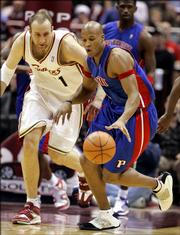 Detroit Pistons' Maurice Evans, right, steals the basketball from Cleveland Cavaliers' Zydrunas Ilgauskas from Lithuania during fourth quarter NBA basketball action Monday, Feb. 27, 2006, in Cleveland. The Pistons beat Cleveland 84-72.