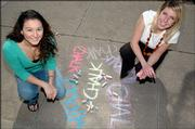 Writers Sara Miller, KU jr., Bonner Springs, left, and Katy Ibsen sr., Boulder. CO. and 22 other KU students worked to create the new Chalk magazine that hits the streets today.