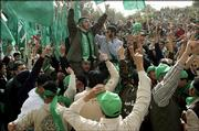 Palestinian Hamas supporters shout slogans as they participate at the campaign rally for the students' council elections at the Arab American university in the northern West Bank town of Jenin Monday Feb. 27, 2006.  The elections are scheduled for Tuesday.  The European Union agreed Monday to provide euro120 million (US$143 million) in urgent aid for Palestinians before the Hamas led government takes office,  a group the bloc considers a terrorist organization.