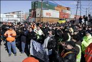 Longshoremen and Teamsters union members  protest against the sale of some American port operations to a state-owned Dubai company at a rally at one of the ports, Port Newark, in Newark, N.J., Monday, Feb. 27, 2006.