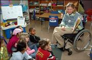 Amanda Trei, special education teacher at Hillcrest Elementary school, reads to students Thursday in a newcomer class. Trei is participating in a Ms. Wheelchair Kansas pageant Sunday in Topeka.