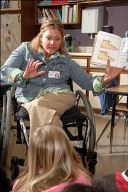 Amanda Trei, special education teacher at Hillcrest Elementary school, reads to students Thursday.