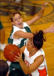 Free State's Jenna Brantley pressures Olathe East's Amanda Miller in the first half, Friday evening at Topeka High School.