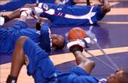 Kansas guard Russell Robinson stretches out with his teammates as the Jayhawks prepare to take on Kansas State, Saturday afternoon at Bramlage Colliseum.