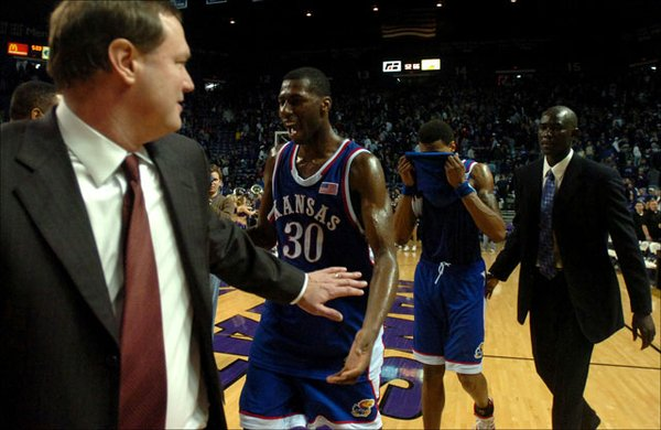 Kansas guard Julian Wright celebrates with head coach Bill Self as the Jayhawks make their way from the court after defeating Kansas State 66-52 Saturday at Bramlage Colliseum.