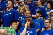 Dejected Kansas fans watch as time dwindles in the Jayhawks 59-55 loss to Kansas State  at Allen Fieldhouse.
