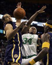 Indiana Pacers' Scot Pollard, left, fouls Boston Celtics' Paul Pierce (34) as Pacers' Stephen Jackson looks on in the first quarter of NBA basketball in Boston, Friday, March 3, 2006.