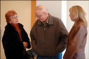 Relatives of Toby Young gather at the Leavenworth County District Court after Young's  appearance Friday. From left are Young's mother and father, Peggy and Jim Phalen, and Young's sister, Julie.