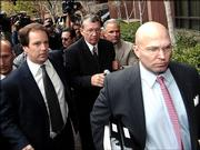 "Former U.S. Congressman Randall ""Duke"" Cunningham, center,  is escorted by aides as he arrives at the federal courthouse in San Diego Friday March 3, 2006 for sentencing on his conviction for bribery and tax evasion."