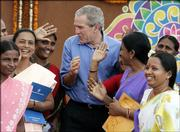 U.S. President George W. Bush, center, meets with rural women discussing ways to empower themselves to a better life during a visit to the Acharya N.G. Ranga Agricultural University in Hyderabad, India, Friday, March 3, 2006.