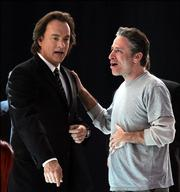 Oscar host Jon Stewart, right, talks to actor Tom Hanks during reahearsals for Sunday's 78th Academy Awards at the Kodak Theatre in Los Angeles, Friday, March 3, 2006.