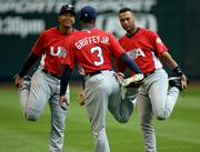 Team USA members, from left, Alex Rodriguez, Ken Griffey Jr. and Derek Jeter stretch before World Baseball Classic practice. The U.S. worked out Saturday in Phoenix.