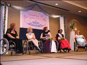 Ranita Wilks, Lawrence, second from right, was crowned Ms. Wheelchair Kansas 2006 on Sunday in Topeka. Other contestants were Amanda Trei, Lawrence; Stacy Ritt, Garden City; and Angel Shaver, Satanta. JoAnne Fluke, Ottawa, who is the Ms. Wheelchair Kansas 2005, is at far right.