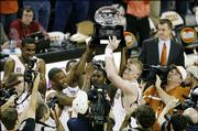Texas' P.J. Tucker, center left, Kenton Paulino, center, and Brad Buckman hold up the Big 12 Conference trophy after their 72-48 victory over Oklahoma. UT's victory Sunday in Austin, Texas, gave the Longhorns a share of the league title - with Kansas University - but the Longhorns earned the Big 12 tournament's top seed by beating KU.