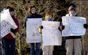 From left, Geralyn Austin, Jane Banse, Will Banse, 11, and Robert Kaufman, 12, all of Upper St. Clair, Pa., parents of students and students in the International Baccalaureate program, protest at the entrance to a school Feb. 17, 2006 in Upper St. Clair. Little battles over the increasingly popular global education program known as International Baccalaureate have been popping up in towns across the country.