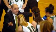 Free State High girls basketball coach Bryan Duncan instructs his players during a timeout against Shawnee Mission West. After serving as an assistant boys basketball coach for five seasons, Duncan took over the Free State girls program at the start of the 2002-03 season. Now, he has the Firebirds in the Class 6A state tournament.