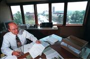 City Manager Mike Wildgen works in his office at City Hall in this fall 1996 file photo. City commissioners asked Wildgen to resign Wednesday, citing concerns about inadequate planning for growth. He has served as city manager for 16 years. His last day will be Friday, and David Corliss, an assistant city manager, will serve as interim city manager.