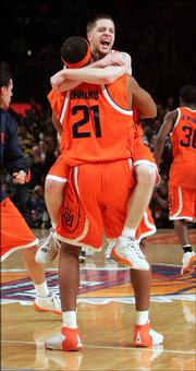Syracuse's Eric Devendorf celebrates with teammate Arinze Onuaku (21) after they defeated top-ranked Connecticut 86-84 in overtime in the quarterfinals of the Big East Men's Basketball Championship Thursday, March 9, 2006 at New York's Madison Square Garden.