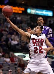 Texas Tech guard Jarrius Jackson (22) shoots a basket as Kansas State guard Mario Taybron (22) defends during the second half of Big 12 Men's Basketball Championship first round game in Dallas, Thursday, March 9, 2006. Jackson scored 21-points in Tech's 73-65 win.