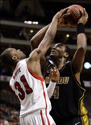 Nebraska's Jamel White (31) blocks a shot attempt by Missouri's Kevin Young, right, in the second half of the Big 12 Men's Basketball Championship first round game in Dallas, Thursday, March 9, 2006.  Nebraska defeated Missouri, 71-64.