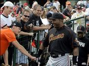 San Francisco Giants' Barry Bonds is greeted by fans as he walks out of the clubhouse to play in his first game of the spring against the  Los Angeles Angels in Tempe, Ariz., Thursday March 9, 2006.