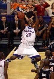 Kansas' Darnell Jackson throws down a first-half dunk.
