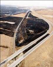 Land is seen near the Kansas Turnpike, Wednesday, March 8, 2006, near El Dorado, Kan. Thick smoke from a massive grass fire northeast of Wichita forced traffic off the Kansas Turnpike northeast of Wichita Wednesday.