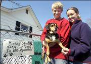 Jared and Whittnie Essner of Scott City, Mo., pose for a photograph in the house they bought with a dog named Rocky, Monday, March 6, 2006, in Scott City, Mo. The 4-year-old beagle mix was written into the real estate contract after the couple became attached to the dog.