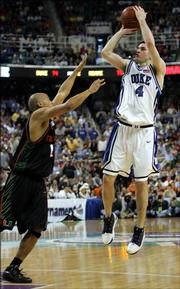 Duke's J.J. Redick (4) shoots over Miami's Guillermo Diaz in the second half during a quarterfinal Atlantic Coast Conference basketball tournament game Friday, March 10, 2006, in Greensboro, N.C.