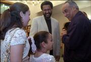 "Kevin Willmott, center, shares a laugh with his daughters, from left, Ruth, 11, and Jody, 9, and Madison D. Lacey during a reception before the Lawrence premiere of Willmott&squot;s film, ""C.S.A.: The Confederate States of America."" About 400 people attended Friday night&squot;s event at Liberty Hall, 642 Mass. Willmott is an associate professor of theater and film at KU."