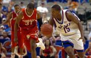 Kansas guard Mario Chalmers breaks up the court past Nebraska guard Jamel White in the second half of play.