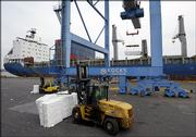 Longshoremen unload wood pulp from a cargo ship Thursday, March 9, 2006, at the Tioga Marine Terminal in Philadelphia.  A Dubai-owned company said Thursday that it was prepared to give up its management stake in some U.S. ports, a move made as congressional leaders warned President Bush that both the House and Senate appeared ready to block the contoversial takeover.