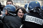 Students scuffle with riot police officers outside the Sorbonne university in Paris, Friday March 10, 2006. Student protests mounted Friday at universities around France over a new jobs law, posing a major test for President Jacques Chirac's government and his ambitious prime minister.