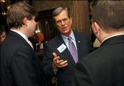 U.S. Sen.Trent Lott, R-Miss., works the crowd outside of the opening session of the Southern Republican Leadership Conference in Memphis, Tenn., on Friday, March 10, 2006.
